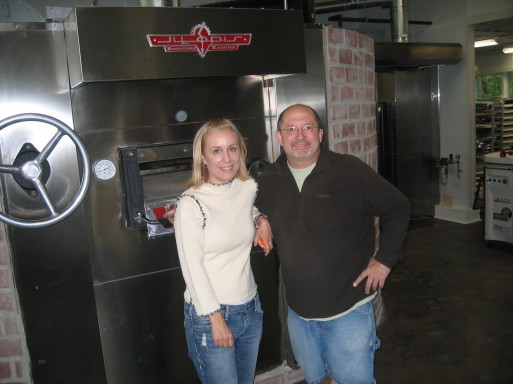 Glenn and Cindy in front of the oven