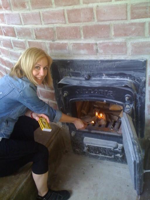 Cindy lighting the oven